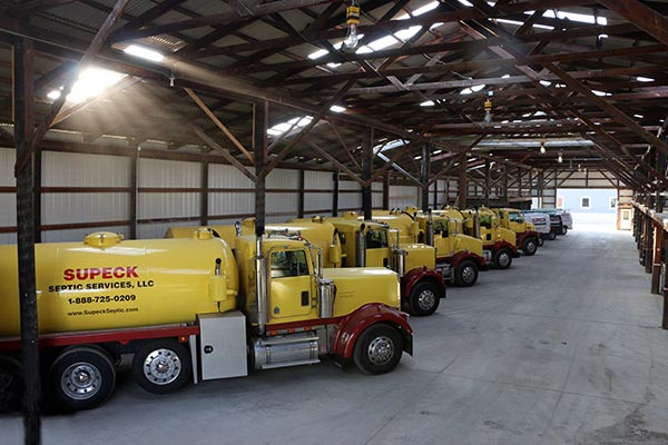 Supeck Septic Services Fleet of Yellow Trucks