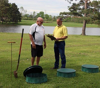 Man meeting with service tech to go over septic service
